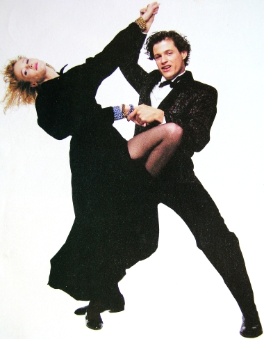 On the dork side: Michael Paré helps model Nancy Donahue with a chiropractic adjustment.